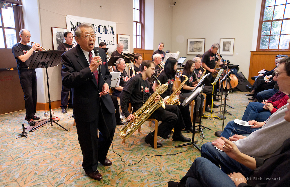 "Vocalist Henry ""Shig"" Sakamoto performs with the Minidoka Swing Band in the US Bank Room of Multnomah County Library - Central branch, Portland, Oregon. The performance was in conjunction with Portland Center Stage's production of Snow Falling on Cedars, by David Guterson."