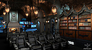 Holy obsession, Batman: Dark Knight superfan spends $2MILLION creating home cinema replica of Bruce Wayne's cave<br /> <br /> A Batman fan has created a $2 million home cinema based on the Gothic look of the Caped Crusader's home.<br /> It includes a Batmobile, batsuits, 180 degree film screen, winged gargoyles, private cylindrical stainless steel elevator with glowing bat symbol, mock secret tunnel exit, bat computers, and race-car inspired home theater chairs.<br /> It is being built by Canadian-basedElite Home Theater Seating at a private home in Greenwich, Connecticut, USA.<br /> <br /> The ornately detailed study of the 12,000 square foot cinema echoes the confines of the home of billionaire Bruce Wayne, whose secret identify is the crime-fighting hero.<br /> <br /> The installation includes a separate study which is the entrance to the hidden cinema. The study, complete with a stately grandfather clock, is flanked by bookshelves upon which sits a bust of William Shakespeare.<br /> A clockwise turn of the writer's head the grandfather clock swings open to reveal the elevator doors. A real fingerprint scan is required to gain access to the elevator.<br /> <br /> <br /> Stepping into the cylindrical stainless steel elevator a glowing Bat symbol pulsates at the bottom of the button panel. To the left of the symbol, is the letter 'B' that stands for Batcave.<br /> <br /> After pressing the iconic glowing bat symbol, the elevator descends and the floor-to-ceiling mirrors on either side of the elevator come alive by displaying various body scanning graphics.<br /> Once the elevator occupants have been properly 'identified', a robotic female voice states over the intercom system, 'Security Clearance Granted'. <br /> The elevator doors slide open with a hydraulic hum.<br /> Entering the subterranean Batcave home theater, the first noticeable detail is the backlit, highly detailed, life-size Batsuit standing at attention across the room.<br /> With a total of six Batsui