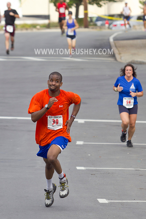 Middletown, New York - People run through the streets of Middletown during the 2012 Run 4 Downtown road race on Saturday, Aug. 18, 2012.