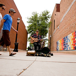 A street musician plays for passer by in downtown Grand Junction. <br /> Photos by Brian Leddy