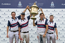 The England Polo team collect the Coronation Cup winners trophy (left to right) Luke Tomlinson, James Harper, Max Charlton and Captain James Beim during the Royal Salute Coronation Cup polo at Windsor Great Park in Surrey.