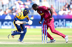 West Indies' Carlos Brathwaite takes the wicket of Sri Lanka's Kusal Perera during the ICC Cricket World Cup group stage match at The Riverside Durham, Chester-le-Street.