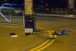 © Licensed to London News Pictures. 26/10/2016. LONDON, UK.  A jacket and personal effects lay on the floor within the first police cordon around East Street near Barking Supermarket in Barking, east London. Police were called at 18:12 on Wednesday 26th October. Officers and the London Ambulance Service attended the scene and found a man in his late 20s with stab wounds to the abdomen. He was taken to an east London hospital where he remains with life threatening injuries.  Photo credit: Vickie Flores/LNP