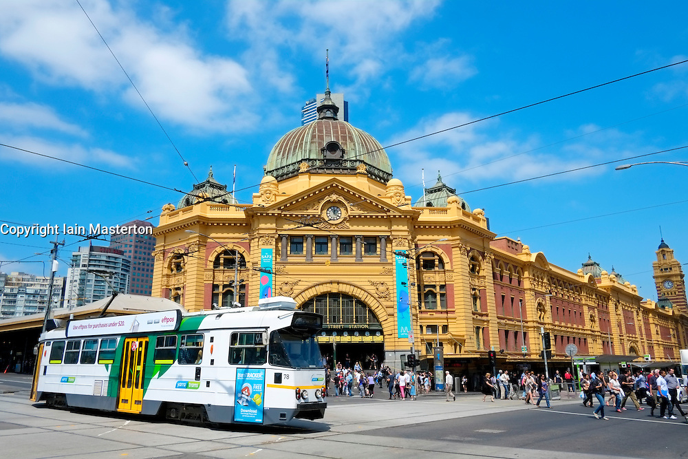 Tram passing in front of historic Flinders Railway Station in central Melbourne Australia