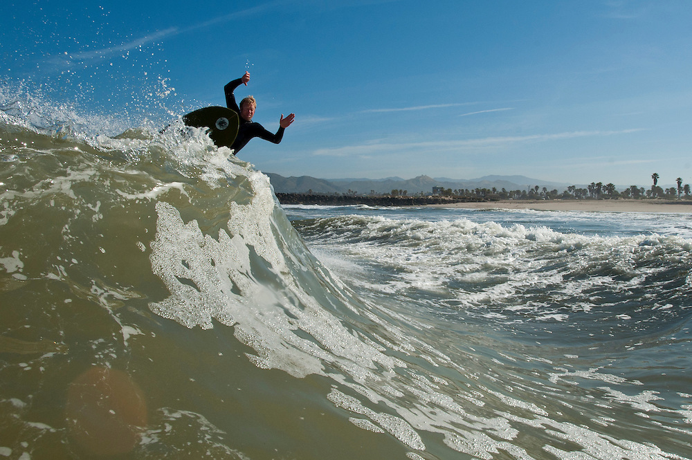 Chris Charney works some lumpy waves on the Ventura coastline, June 3, 2011.  The local artist tries to surf every morning as he finds the sport to be both the inspiration and focus of his art. (Photo by Aaron Schmidt © 2011)