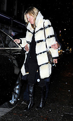 Kate Moss wearing a white & black fur coat, black top with poka-dot collars, skinny jeans and a pair of black knee high boots out in north London. The supermodel was spotted arriving at Japanese restaurant holding a bottle of beer. Kate looks as if she has started her birthday celebrations early as left the restaurant looking a little worse for wear. The supermodel  will celebrate her birthday this weekend 13/01/2016<br /> BYLINE MUST READ : JAMESY/GOTCHA IMAGES<br /> <br /> Copyright by © Gotcha Images Ltd. All rights reserved.<br /> Usage of this image is conditional upon the acceptance <br /> of Gotcha Images Ltd, terms and conditions available at<br /> www.gotchaimages.com