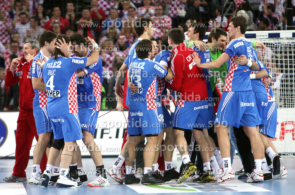 Team of Croatia celebrates (left Balic and Vori) during 21st Men's World Handball Championship 2009 semifinals match between National teams of Poland and Croatia, on January 30, 2009, in Arena Zagreb, Zagreb, Croatia.  (Photo by Vid Ponikvar / Sportida)