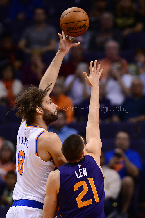 Mar 9, 2016; Phoenix, AZ, USA; New York Knicks center Robin Lopez (8) shoots the ball over Phoenix Suns center Alex Len (21) at Talking Stick Resort Arena. The Knicks defeated the Suns 128-97. Mandatory Credit: Jennifer Stewart-USA TODAY Sports