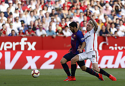 February 23, 2019 - Seville, Madrid, Spain - Simon Kjaer (Sevilla FC)and Luis Suarez (FC Barcelona) are seen in action during the La Liga match between Sevilla FC and Futbol Club Barcelona at Estadio Sanchez Pizjuan in Seville, Spain. (Credit Image: © Manu Reino/SOPA Images via ZUMA Wire)