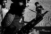 Jabalya Refugee Camp, Gaza 1988. Children with toy guns during the Intifada against the Israeli occupation.