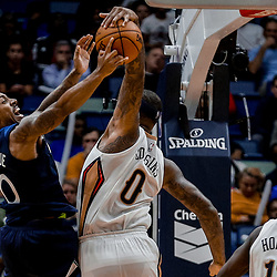 Nov 1, 2017; New Orleans, LA, USA; New Orleans Pelicans center DeMarcus Cousins (0) blocks Minnesota Timberwolves guard Jeff Teague (0) during the second half of a game at the Smoothie King Center. The Timberwolves defeated the Pelicans 104-98. Mandatory Credit: Derick E. Hingle-USA TODAY Sports