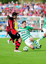 Yeovil Town's Edward Upson challenges Bournemouth's Richard Hughes - Photo mandatory by-line: Dougie Allward/Josephmeredith.com  - Tel: Mobile:07966 386802 08/09/2012 - SPORT - FOOTBALL - League 1 -  Yeovil  - Huish Park -  Yeovil Town v AFC Bournemouth