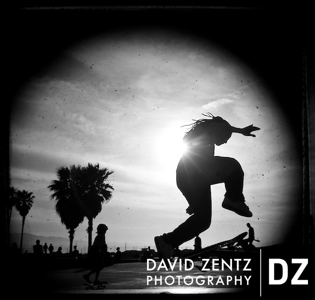Silhouetted skateboarders are seen through the viewfinder of an antique Hasselblad at Venice Beach, Calif., on Sunday, May 3, 2009.