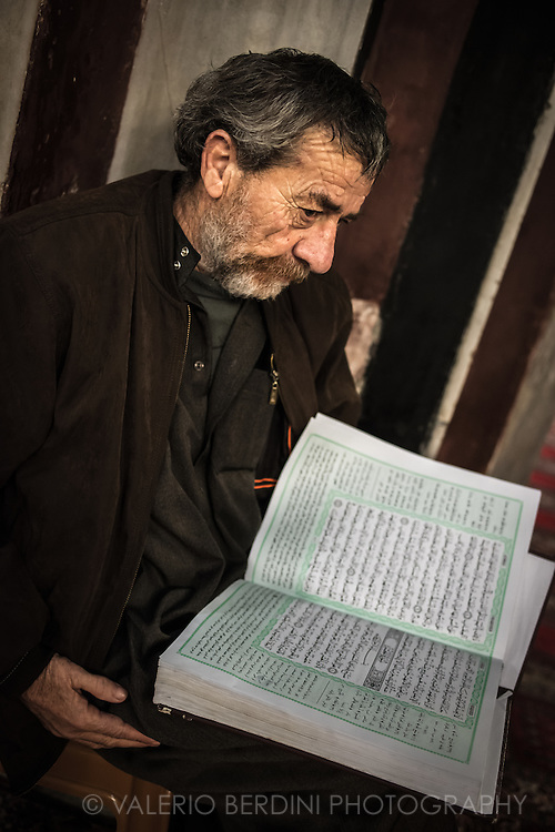 A man reads the Koran inside Ibrahim Mosque in Hebron. In 1994 inside this mosque an american Jewish settler killed 29 and injured 125 Muslims that were celebrating with prayers the end of Ramadam. Despite Israel strongly condamned the massacre, some Hebron settlers consider him a hero.