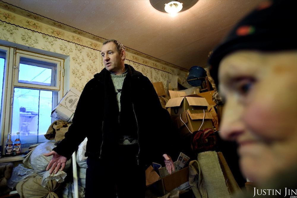 Nina Merzlikina, 75, and Sergei Kostenko, 45, have packed up their belongings at this apartment in Yor Shor village in expectation of eviction by bailiffs. Local officials want to close the village, near Vorkuta town, so they can shut off supplies of gas and electricity..Vorkuta is a coal mining and former Gulag town 1,200 miles north east of Moscow, beyond the Arctic Circle, where temperatures in winter drop to -50C. .Here, whole villages are being slowly deserted and reclaimed by snow, while the financial crisis is squeezing coal mining companies that already struggle to find workers..Moscow says its Far North is a strategic region, targeting huge investment to exploit its oil and gas resources. But there is a paradox: the Far North is actually dying. Every year thousands of people from towns and cities in the Russian Arctic are fleeing south. The system of subsidies that propped up Siberia and the Arctic in the Soviet times has crumbled. Now there's no advantage to living in the Far North - salaries are