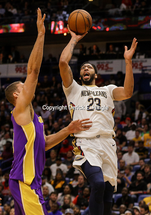 Mar 22, 2018; New Orleans, LA, USA; New Orleans Pelicans forward Anthony Davis (23) shoots over Los Angeles Lakers center Brook Lopez (11) during the second half at the Smoothie King Center. The Pelicans defeated the Lakers 128-125. Mandatory Credit: Derick E. Hingle-USA TODAY Sports