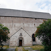 There has been a wooden church in Källa since the 11th century. After it was destroyed by fire, and with increasing attacks from Baltic invaders, a new church was built with stones, looking more like a fortress in the 13th century. <br />  Källahamnsvägen 77 Löttorp, Öland, Sweden<br /> Photography by Jose More
