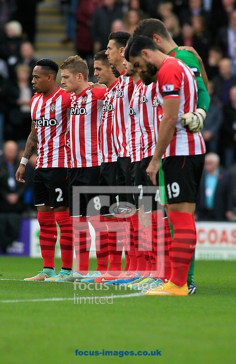 The Remembrance 1 minute silence shows the Southampton team before KO of the Barclays Premier League match at KC Stadium, Hull<br /> Picture by Richard Gould/Focus Images Ltd +44 7855 403186<br /> 01/11/2014