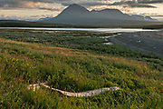Sunset over the Chigmit Mountains at the McNeil River State Game Sanctuary on the Kenai Peninsula, Alaska. The remote site is accessed only with a special permit and is the world's largest seasonal population of brown bears in their natural environment.