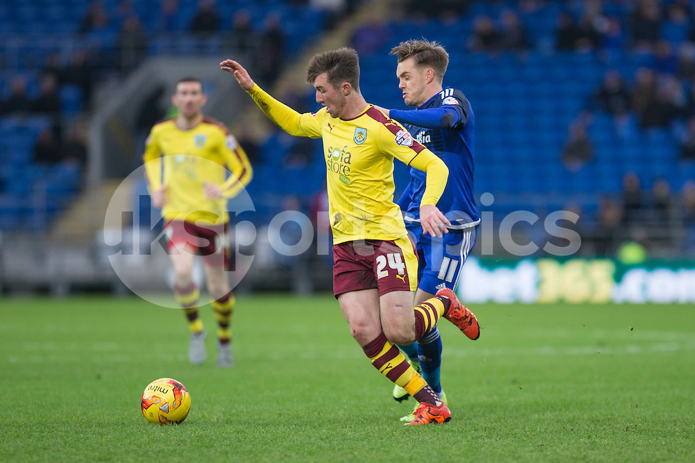 Chris Long of Burnley is pressured by Craig Noone of Cardiff City during the Sky Bet Championship match between Cardiff City and Burnley at the Cardiff City Stadium, Cardiff, Wales on 28 November 2015. Photo by Mark Hawkins.