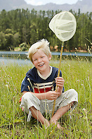 Boy Catching Bugs