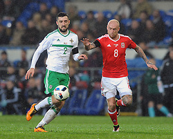 Conor McLaughlin of Northern Ireland and David Cotterill of Wales - Mandatory by-line: Dougie Allward/JMP - Mobile: 07966 386802 - 24/03/2016 - FOOTBALL - Cardiff City Stadium - Cardiff, Wales - Wales v Northern Ireland - Vauxhall International Friendly