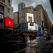 Manhattan remains virtually empty with closed businesses and limited traffic due to the Coronavirus (Covid-19) outbreak in New York City on Monday, May 11, 2020.  Nonessential businesses have been closed and large gatherings have been banned across the state since March 22 under an emergency order issued by Governor Cuomo that is set to expire on Friday. (Alex Menendez via AP)