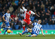Clayton Donaldson and Lewis Dunk, Brighton defender during the Sky Bet Championship match between Brighton and Hove Albion and Birmingham City at the American Express Community Stadium, Brighton and Hove, England on 21 February 2015.