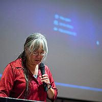 Holly Yasui introduces a film and play that she directed about Japanese American activist and lawyer Minoru Yasui during a presentation at UNM-Gallup Monday.