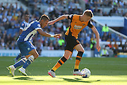 Hull City midfielder Sam Clucas takes the ball away from Brighton central midfielder, Beram Kayal during the Sky Bet Championship match between Brighton and Hove Albion and Hull City at the American Express Community Stadium, Brighton and Hove, England on 12 September 2015. Photo by Phil Duncan.