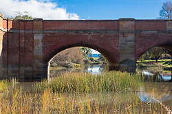 View through the arches of Campbell Town's Red Bridge, built in 1838.