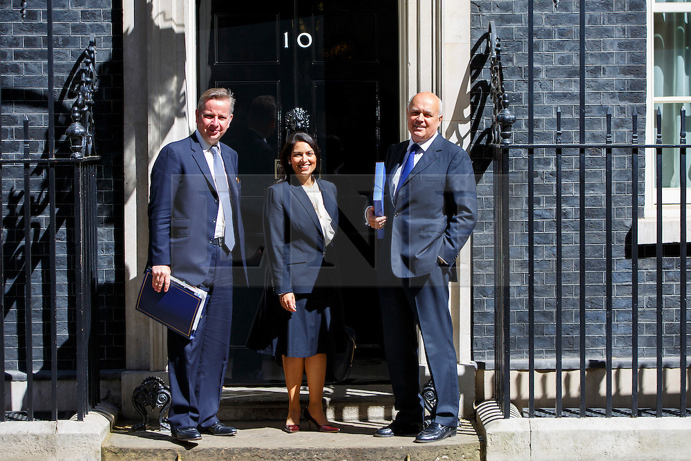 © Licensed to London News Pictures. 12/05/2015. LONDON, UK. Justice Secretary Michael Gove, Minister for Employment Priti Patel, Work and Pensions Secretary Iain Duncan Smith attending to the first Conservative cabinet meeting after the 2015 general election in Downing Street on Tuesday, 12 May 2015. Photo credit: Tolga Akmen/LNP
