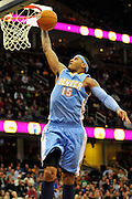 Jan. 28, 2011; Cleveland, OH, USA; Denver Nuggets small forward Carmelo Anthony (15) dunks during the third quarter against the Cleveland Cavaliers at Quicken Loans Arena. The Nuggets beat the Cavaliers 117-103. Mandatory Credit: Jason Miller-US PRESSWIRE