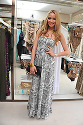 NOELLE RENO at the opening of the new Melissa Odabash store in Walton Street, London SW3 on 7th July 2011.