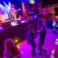 Visitors swing to the tunes of The Salty Suites at The Cave in Big Bear Lake, Friday, March, 10, 2017. Big Bear entrepreneur David Stone is the owner of The Cave, Big Bear Lake Brewing Company and the soon to open Black Kat restaurant. (Eric Reed/For The Sun/SCNG)