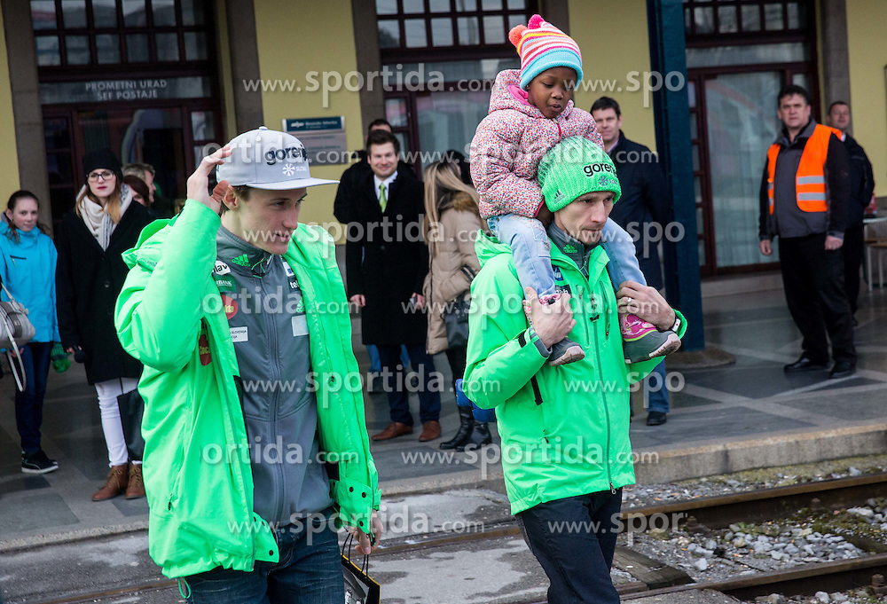Peter Prevc and Robert Kranjec with his daughter Pika prior to the driving of Slovenian National Ski jumping Team from Ljubljana by train to the FIS World Cup Ski Jumping Final Planica 2016, on March 16, 2016 in  Slovenia. Photo by Vid Ponikvar / Sportida