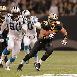 2008 December, 28: New Orleans Saints running back Deuce McAllister (26) runs away from Carolina Panthers defensive end Julius Peppers (90) during a 33-31 week 17 loss by the New Orleans Saints to NFC South divisional rivals the Carolina Panthers at the Louisiana Superdome in New Orleans, LA.