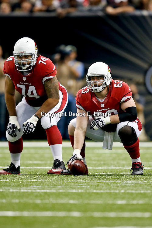 Sep 22, 2013; New Orleans, LA, USA; Arizona Cardinals guard Paul Fanaika (74) and center Lyle Sendlein (63) against the New Orleans Saints during a game at Mercedes-Benz Superdome. The Saints defeated the Cardinals 31-7. Mandatory Credit: Derick E. Hingle-USA TODAY Sports