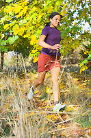 Young woman running with MP3 player.
