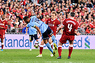 May 24, 2017:Sydney FC forward Alex BROSQUE (captain) (14) and Liverpool FC player Jamie Carragher (4) go for the ball at the soccer match, between English Premiere League team Liverpool FC and Sydney FC, played at ANZ Stadium in Sydney, NSW Australia.