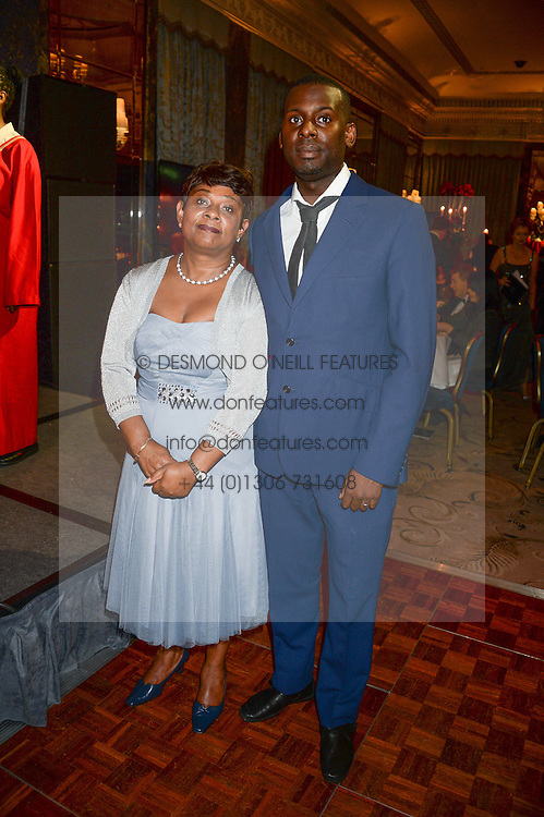 BARONESS LAWRENCE OF CLARENDON and her son STUART LAWRENCE at the inaugural Stephen Lawrence Memorial Ball held at The Dorchester, Park Lane, London on 17th October 2013.