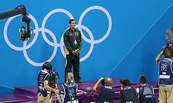 29th July 2012 - London 2012 Olympic Games - Swimming - Men's 100m Breaststroke Final - Cameron van de Burgh (RSA) stands on the podium with his gold medal - Photo: Simon Stacpoole / Offside./SPORTZPICS
