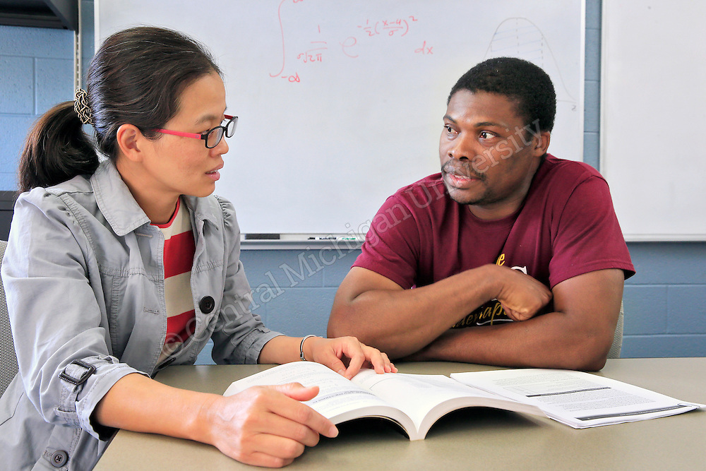 Mathematics Dept. at Central Michigan University. From left:  Chin-I Cheng, Associate Faculty works with Olaseni Fadipe, Graduate Student. Photos by Steve Jessmore/Central Michigan University
