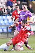 Barney Williams blocks Dan Holman during the Vanarama National League match between Welling United and Cheltenham Town at Park View Road, Welling, United Kingdom on 5 March 2016. Photo by Antony Thompson.