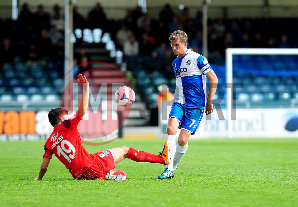 Bristol Rovers' Lee Mansell is challenged by AFC Telford's Jordan Deacey - Photo mandatory by-line: Neil Brookman - Mobile: 07966 386802 23/08/2014 - SPORT - FOOTBALL - Bristol - Memorial Stadium - Bristol Rovers v AFC Telford - Vanarama Football Conference