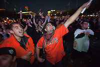 SAN FRANCISCO, CA - NOV 1:  San Francisco Giants fans Miguel Ochoa (C) reacts after watching Edgar Renteria hit a 3 run homerun in the 7th inning as the Giants defeat the Texas Rangers to win the World Series in 5 games at the Civic Center Plaza on November 1, 2010 in San Francisco, California.  The Giants won their first World Series in 56 years since moving to San Francisco from New York.  Photograph by David Paul Morris