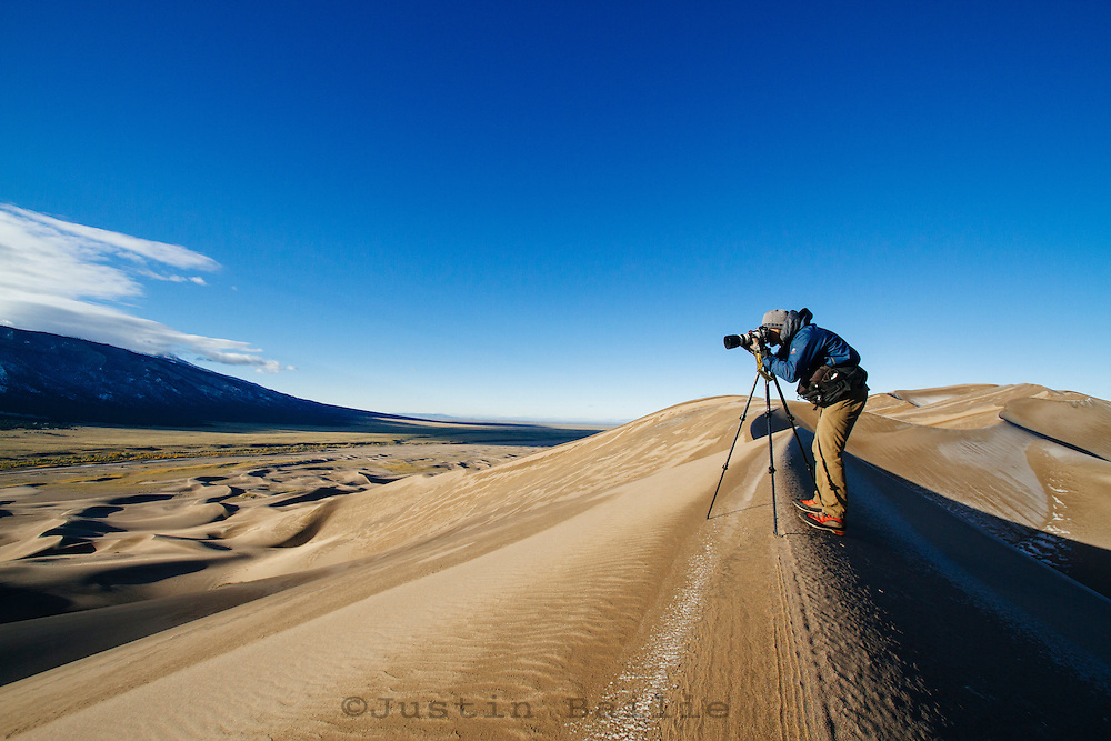 Professional photographer creating photos in Great Sand Dunes National Park, CO.