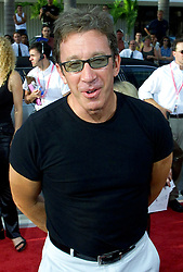 "Actor Tim Allen jokes with the media August 21, 2000 as he attends the premiere of the Movie ""The Crew"" on Miami Beach. The movie, which was filmed on Miami Beach,  stars Burt Reynolds, Richard Dreyfuss, Dan Hedaya and Seymour Cassel. REUTERS/Colin Braley"