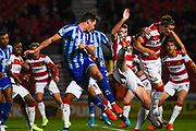 Blackpool defender Ben Heneghan (6) Doncaster Rovers midfielder Ben Whiteman (8) and Doncaster Rovers midfielder Ben Sheaf (6) in action during the EFL Sky Bet League 1 match between Doncaster Rovers and Blackpool at the Keepmoat Stadium, Doncaster, England on 17 September 2019.