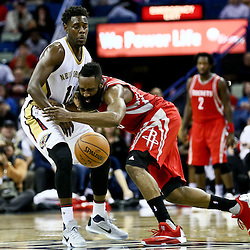 Jan 25, 2016; New Orleans, LA, USA; Houston Rockets guard James Harden (13) collides with New Orleans Pelicans guard Jrue Holiday (11) during the second half of a game at the Smoothie King Center. The Rockets defeated the Pelicans 112-111. Mandatory Credit: Derick E. Hingle-USA TODAY Sports
